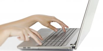 Woman typing on notebook