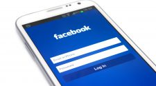 A touchscreen smartphone running Facebook